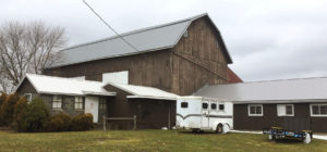 A large barn with a beautiful metal roof installed in Rochester